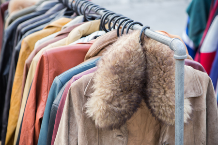 clothes rack: Second hand of Winter clothes hanged on a clothes rack