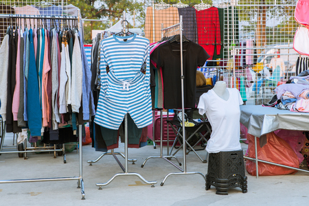 clothes rack: clothes hanging on a rack in market