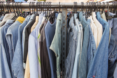 shoulder buttons: Second hand variety shirt on rack in market
