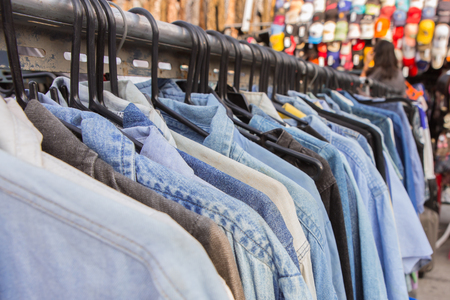 shoulder buttons: Selective focus blue jeans shirt on rack