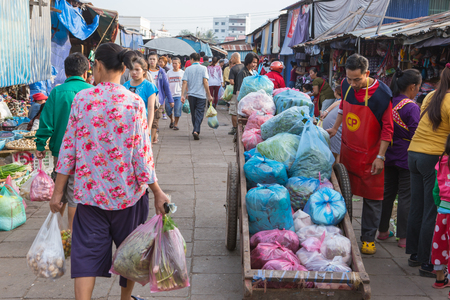 COSTUMERS: Vientiane,Laos- Jan 17 ;Many Vendors and costumers of Lao selling and buying local food and product in Morning Market Vientiane on January 17,2016 . Vientiane , Laos