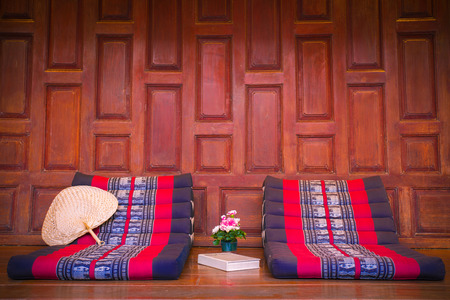 cofffee: Triangle pillow seat with book , Thai tradition Stock Photo