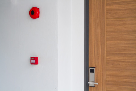keycard: Door handle keycard security with fire alarm Stock Photo