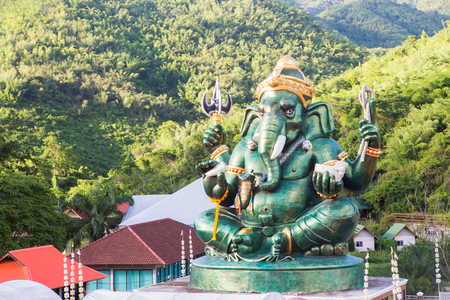 god ganesh: Giant Hindu God Ganesh on top of the building in a temple in Thailand