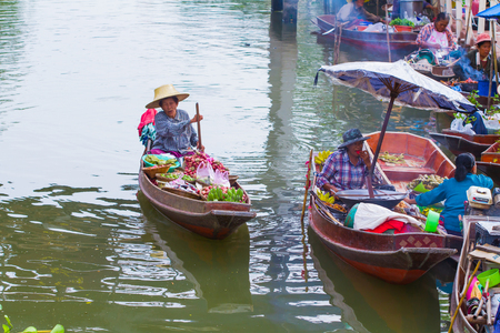 saduak: AMUT SONGKHRAM, THAILAND -June 12 :Local merchant sell food ,fruits and product at Thaka floating market,on June 12,2016 in Samutsongkhram,Thailand. Thaka is a popular tourist attraction.