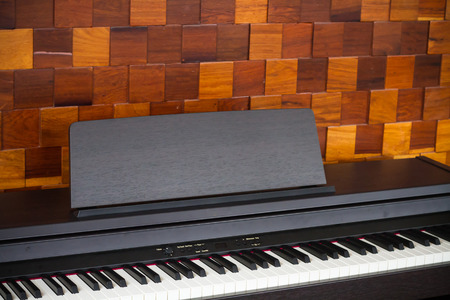 music therapy: Selective focus piano keyboard with wood plate wall