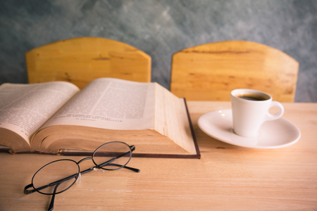 tabel: Selective focus glasses on wood tabel with book and coffee Stock Photo