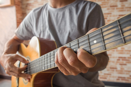 Hand of man playing classical guitar Stock Photo