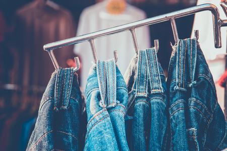 Holder belt of jeans on hanger in market Stock Photo