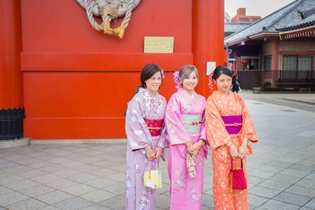 TOKYO-JAPAN-OCTOBER  14,2016 ; Tree women wearing Kimono suit at Asakusa Shrine temple , this temple famous from Japanese people and tourist a lot of  visit