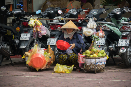 HO CHI MINH (SAI GON), VIET NAM- OCTOBER 4: Street vendor with fruit store on bicycle , Sai Gon, Viet Nam on October 4, 2016