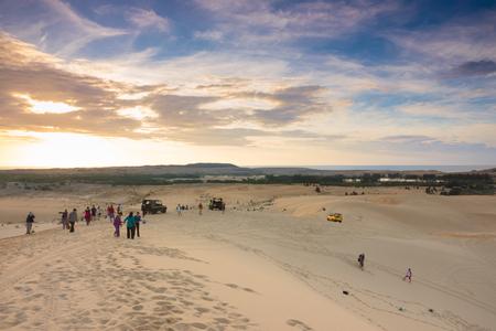 ne: MUI NE - VIETNAM - OCTOBER 12,2016 ;Tourist seeing sunlight at White Sand Dunes in Mui Ne, Phan Thiet, Vietnam. This place popular tourist attraction Editorial