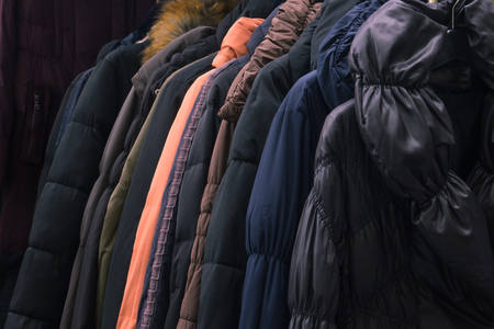 Second hand leather clothes hanging on a rack in market Stock Photo
