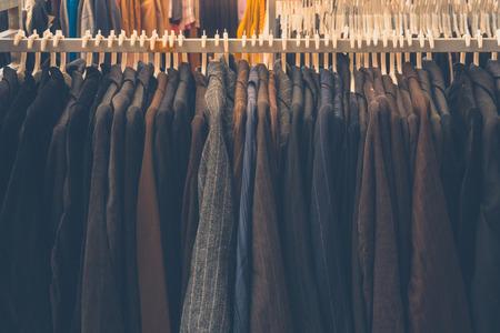 garb: Fashion jacket on hangers , Retro image Stock Photo