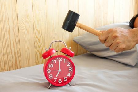Smashing Alarm Clock with Hammer