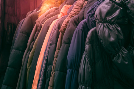 retailer: Second hand leather clothes hanging on a rack in market Stock Photo