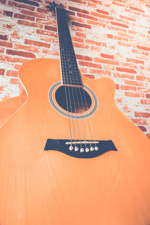 wood table: Acoustic guitar on wood table