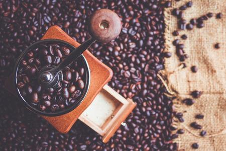 coffee grinder: Top view vintage manual coffee grinder with beans
