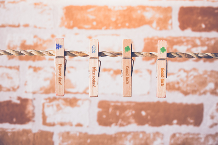 Wooden clothespins on a rope and wording  Happy day , Nice today,Good luck,  Stock Photo
