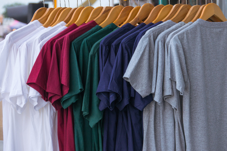 Various color of T-shrit on rack Stock Photo