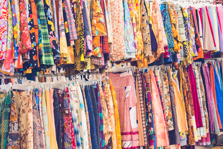 Vintage cloth on rack in market Stock Photo