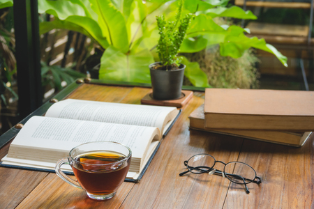A cup of tea with books on table