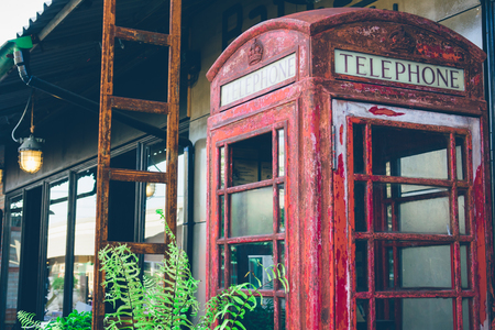 defaced: Abandoned  British red public telephone box.