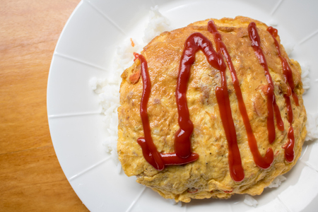 Tradition omelet with above rice with tomato sauce on top Stock Photo