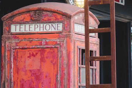 Abandoned British red public telephone box. Stock Photo
