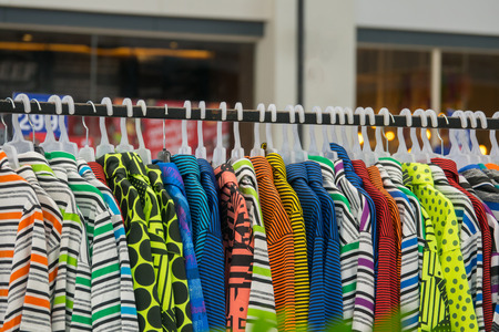 Colorful of T-shirt on rack Stock Photo