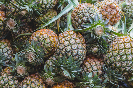 Fresh pineapples on market in Thailand Stock Photo