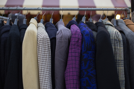 Winter coats hanged on a clothes rack. Stock Photo