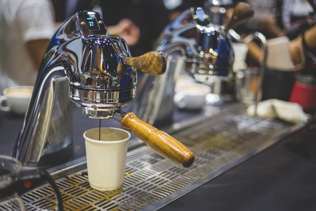 Close-up of espresso pouring from coffee machine. Professional coffee brewing Stock Photo