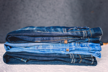 Stack of denim jean with black color background Stock Photo