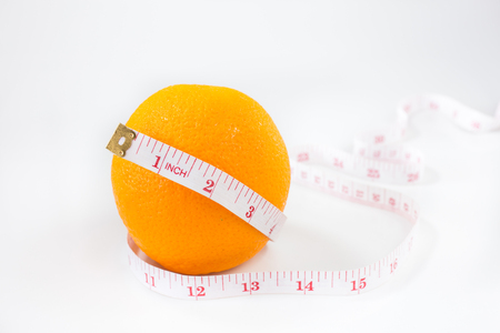Fresh orange with measuring tape on white background