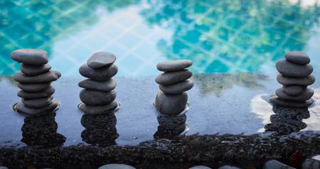 zen stones on pool ,relax and sapa concept Stock Photo