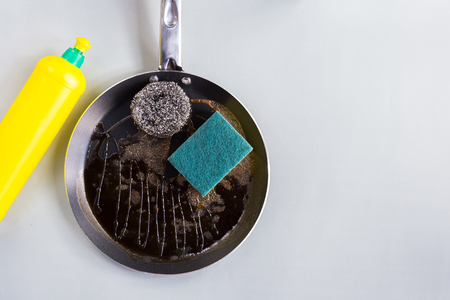 Sponges and stell wool for  clean a frying pan with dishwashing liquid