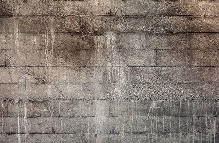 Textuur van donkergrijze bakstenen muur. Stockfoto