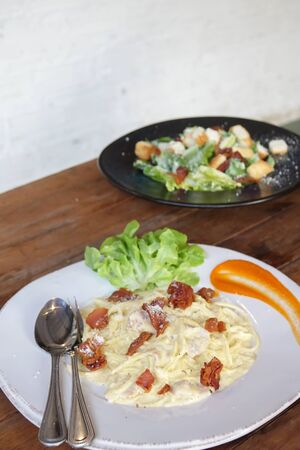 Spaghetti Carbonara with Bacon and Ham in White dish