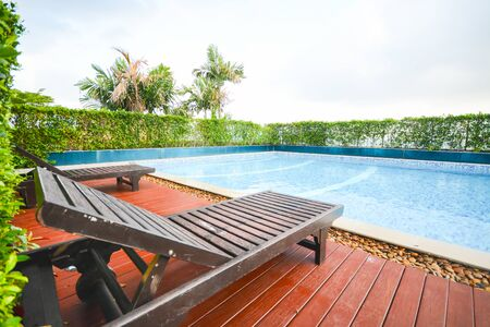 Wooden pool bed at the swimming pool