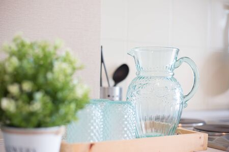 Empty Glass bottle of water with drinking glass  on the table in kitchen Archivio Fotografico