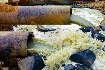 pipe water pipeline: Discharge of liquid chemical waste. The danger for the environment.