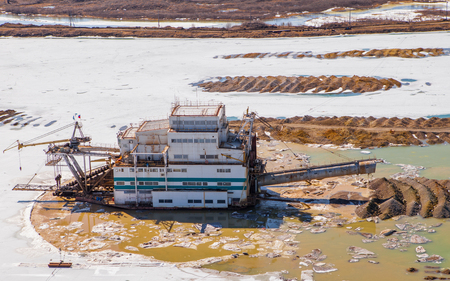 dredge: Dredge extracts gold