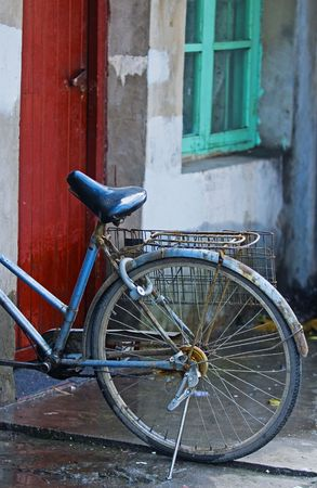 Old bicycle in chinese street in Shanghai photo