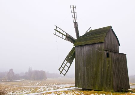 windmill in ukranian village at winter time photo