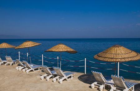 sunshades: sunshades in Turkish resort in the Aegean sea Stock Photo