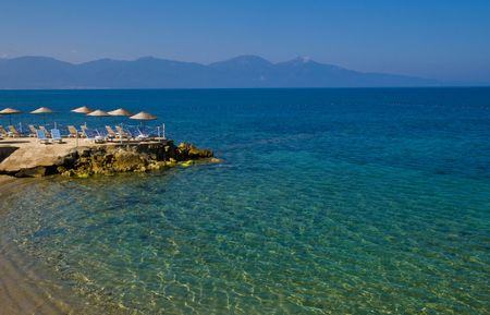sunshades in Turkish resort in the Aegean sea Stock Photo - 4501687