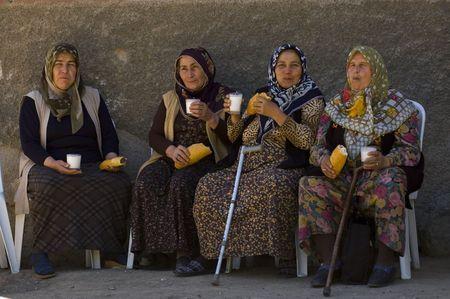Ankara Turkey May 2007 - Turkish women having lunch in the street  Stock Photo - 6885397