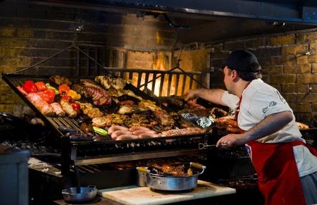 montevideo: MONTEVIDEO, URUGUAY - NOV 22 2008 :  barbecue in the famous Mercado del poerto