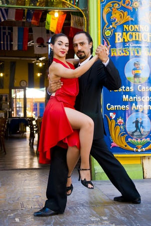 BUENOS AIRES  , ARGENTINA  - APR 10 2009  :  couple dancing tango in the street   Editorial